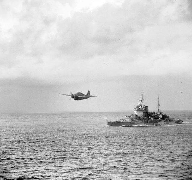 Grumman martlet flying over warspite